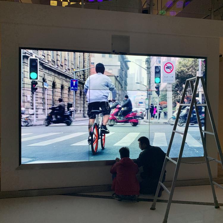 深国投广场三星55寸1.7mm 3行3列液晶亿博客服屏+体感互动屏项目竣工